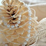 Christmas decoration with fir cone and pearl string, close-up